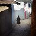 Little girl running in Harar old city, Ethiopia by Alex_Saurel