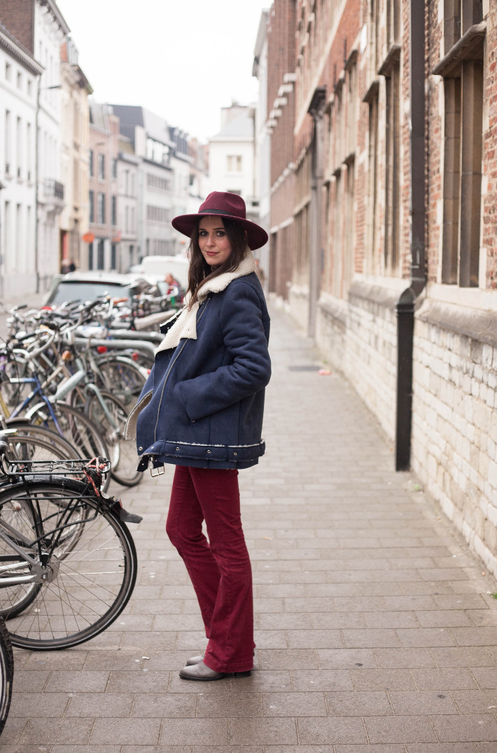 Outfit: burgundy hat with shearling biker coat