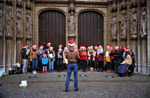 Christmas caroling in front of the cathedral