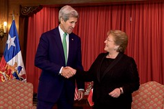 U.S. Secretary of State John Kerry shakes hands with Chilean President Michelle Bachelet before their bilateral meeting at the at the Cerro Castillo Presidential House in Valparaiso, Chile, on October 5, 2015. [State Department photo/ Public Domain]