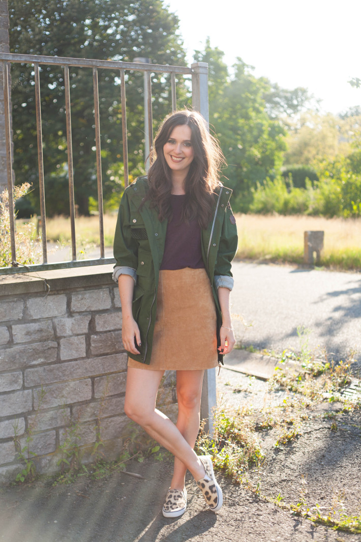 Outfit: suede A-line skirt, parka and leopard slip ons