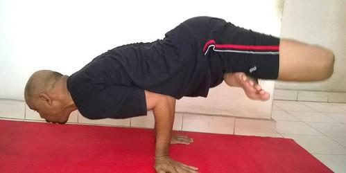 Yogagurusuneelsingh in Padamayurasana