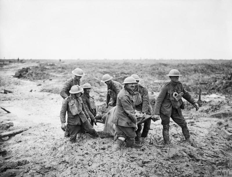 Stretcher bearers struggle in mud up to their knees to carry a wounded man to safety near Boesinghe on 1 August 1917 during the Third Battle of Ypres.