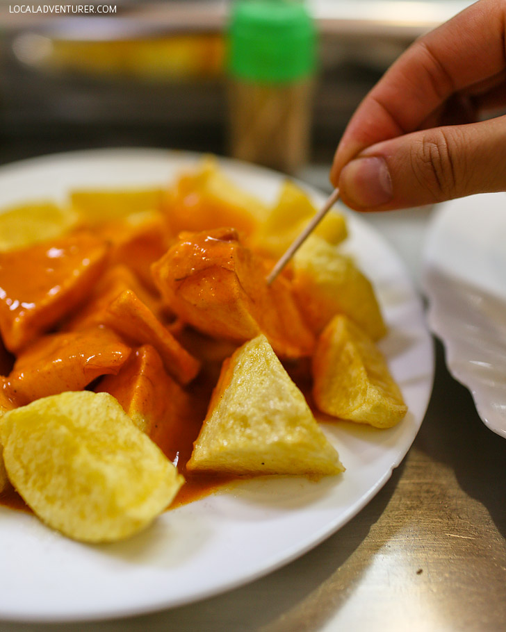 Patatas Bravas - must try in Spain - It's one of the most common tapa in Spain. Also see the other 15 Spanish foods you must try when visiting Spain.