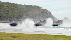 In this file photo, landing craft air cushions (LCAC) approach the beach during an amphibious assault with the Royal Thai Navy and U.S. Marines during exercise Cooperation Afloat Readiness and Training (CARAT) Thailand 2015. (U.S. Navy/MC1 Jay C. Pugh)