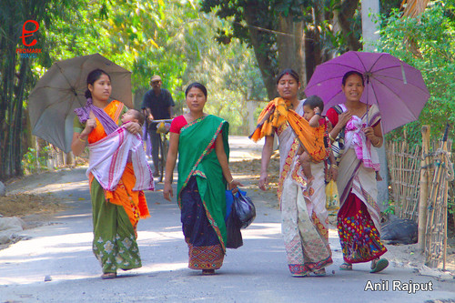 Tribe ladies in home woven colorful cloths , Majuli Island