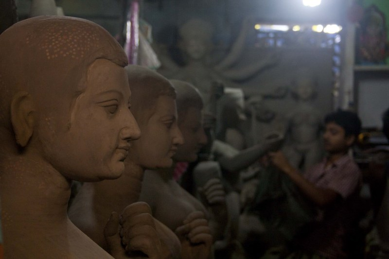 Artisans Working on Unfinished Idol - at Kumortuli, Kolkata, India