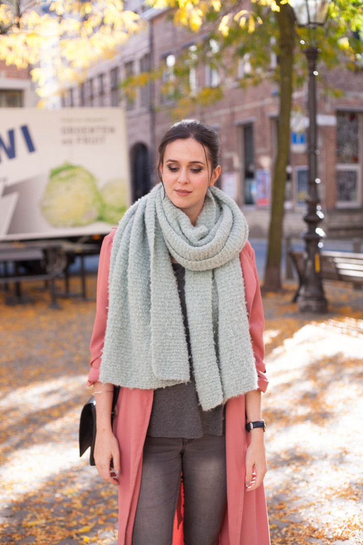 pink duster coat, mint oversized scarf
