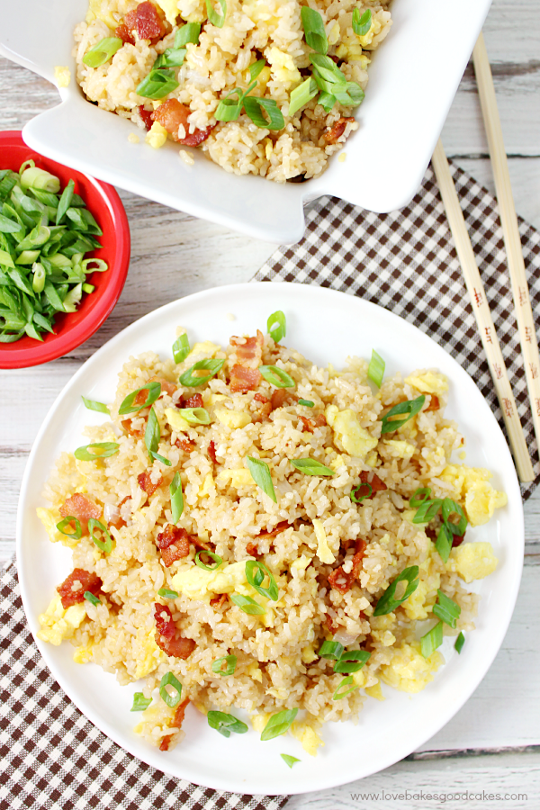 Bacon & Egg Breakfast Fried Rice on a plate looking down with chop sticks.
