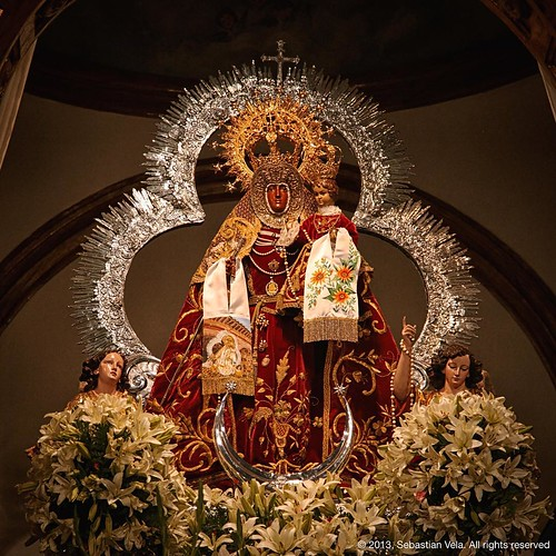 In Andalusia, society not specially inclined to secularism, almost every municipality has its holy figure, which revolve around local festivities. In this picture, we observe the