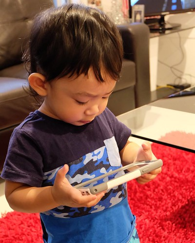 Here's Baby Louis holding my phone while watching a Disney movie like a boss 😄  Dayum! He's growing up so fast! 👶  Ate missed you, Cutie Patootie! 😙  #babysitting #babysitting101 #ateduties #kidsthesedays #toddlers #toddler