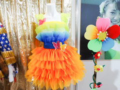 party(0.0), orange(1.0), dance dress(1.0), flower(1.0), clothing(1.0), yellow(1.0),