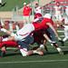 Brock Davies, Brandon Payer and Ryan Merrill make a tackle.