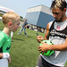 Diego Fagundez signs an autograph at Revs Training