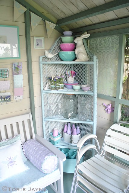 Summer house corner shelving