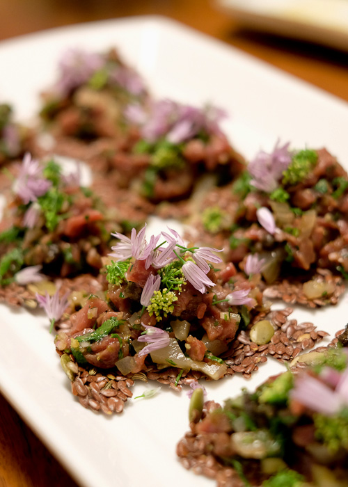 Veal heart tartare on homemade linseed crackers