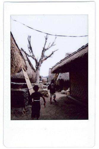 Children running in Sade Village Lombok