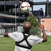 Jose Goncalves juggles the ball on his head at Revs Training