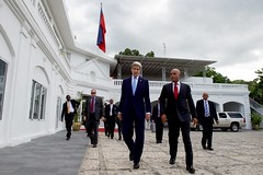 U.S. Secretary of State John Kerry and Haitian President Michel Martelly walk the grounds of the Presidential Palace in betweetn meetings in Port-au-Prince, Haiti, on October 6, 2015. [State Department photo/ Public Domain]