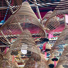 Incense hanging from the ceiling inside of #ManMo temple in #hongkong #travel #buddhism
