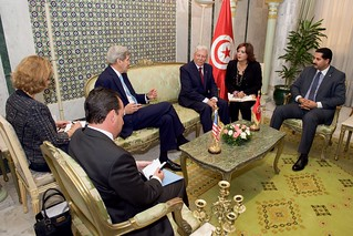 Secretary Kerry and his Delegation Sit with Foreign Minister Baccouche Before a Bilaterial Meeting at the Ministry of Foreign Affairs in Tunis
