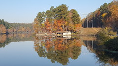 Boat house basking in Autumn colors
