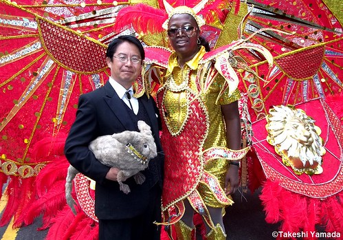 Dr. Takeshi Yamada and Seara (Coney Island sea rabbit) with the beautiful parader at the West Indian American Day Parade (Labor Day Parade) at the Eastern Parkway in Crown Heights in Brooklyn, NY on September 5, 2011. 20110905 100_2386-c-----