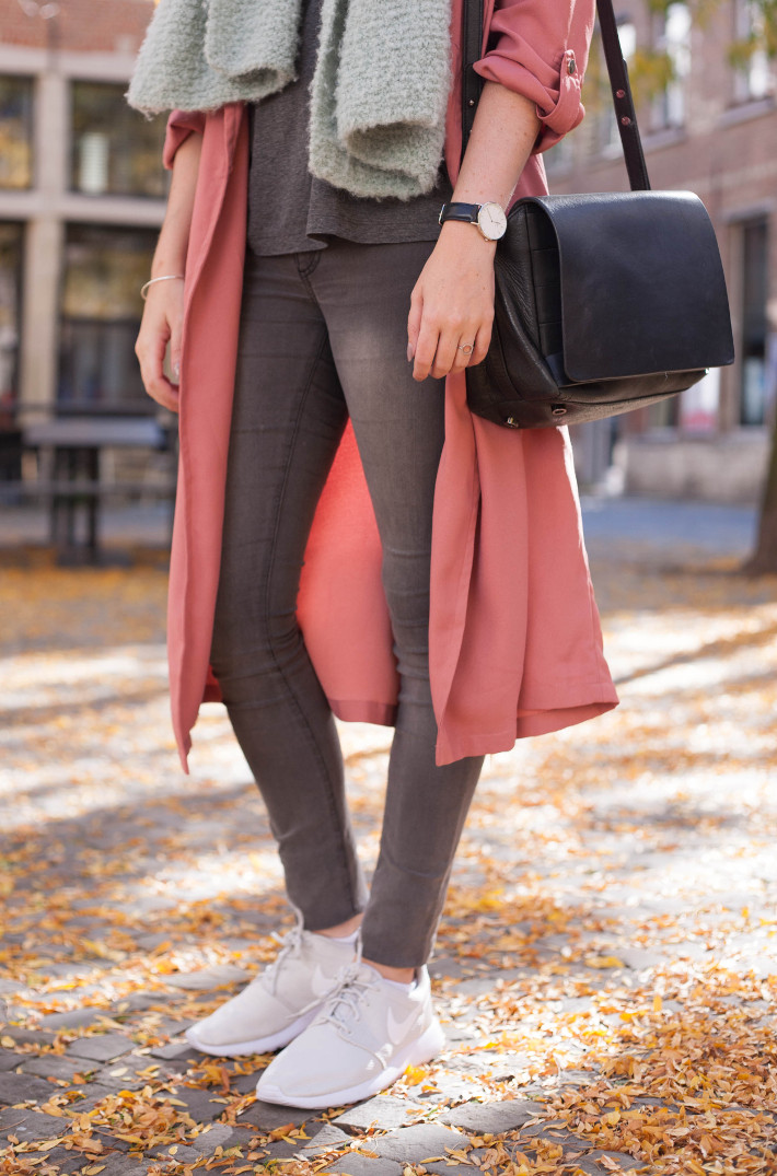 Outfit: pink duster coat, white Nike roshe runs