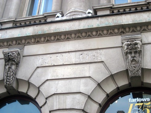 Faces on the Corner of Waterloo Place and Pall Mall