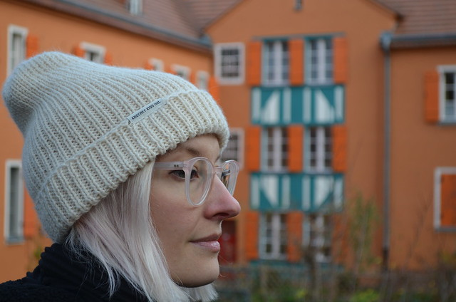 Krochet Kids Intl knit hat and Ace and Tate Lucca glasses at UNESCO World Heritage Site Berlin Modernism Housing Estates Gartenstadt Falkenberg Garden City Tuschkastensiedlung