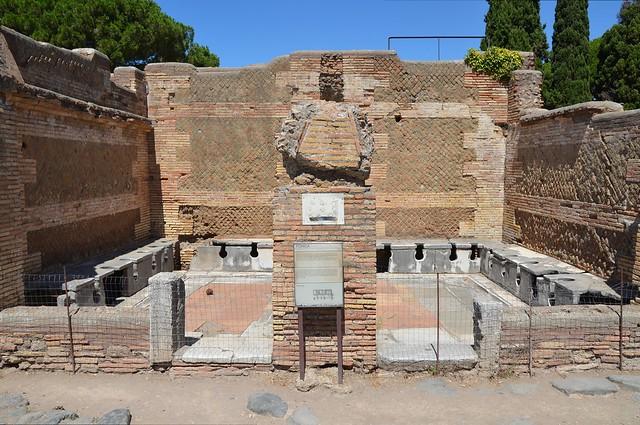 Regio I - Forica (latrine), Ostia Antica, Italy