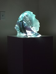 White Laminate Pedestal with Spotlight and Sculpture