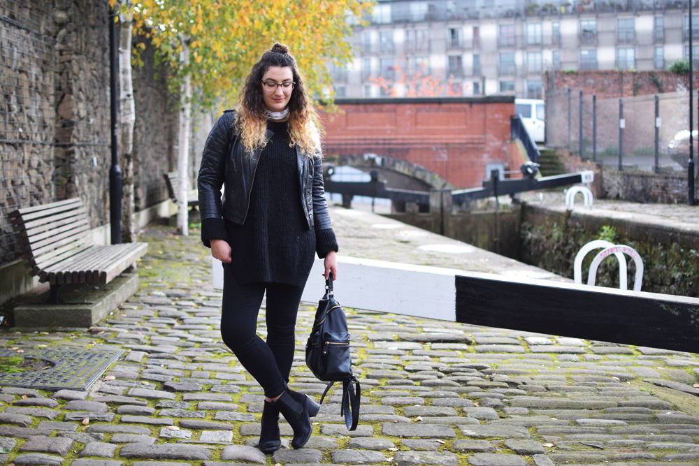 wearing all black and chunky heel ankle boots