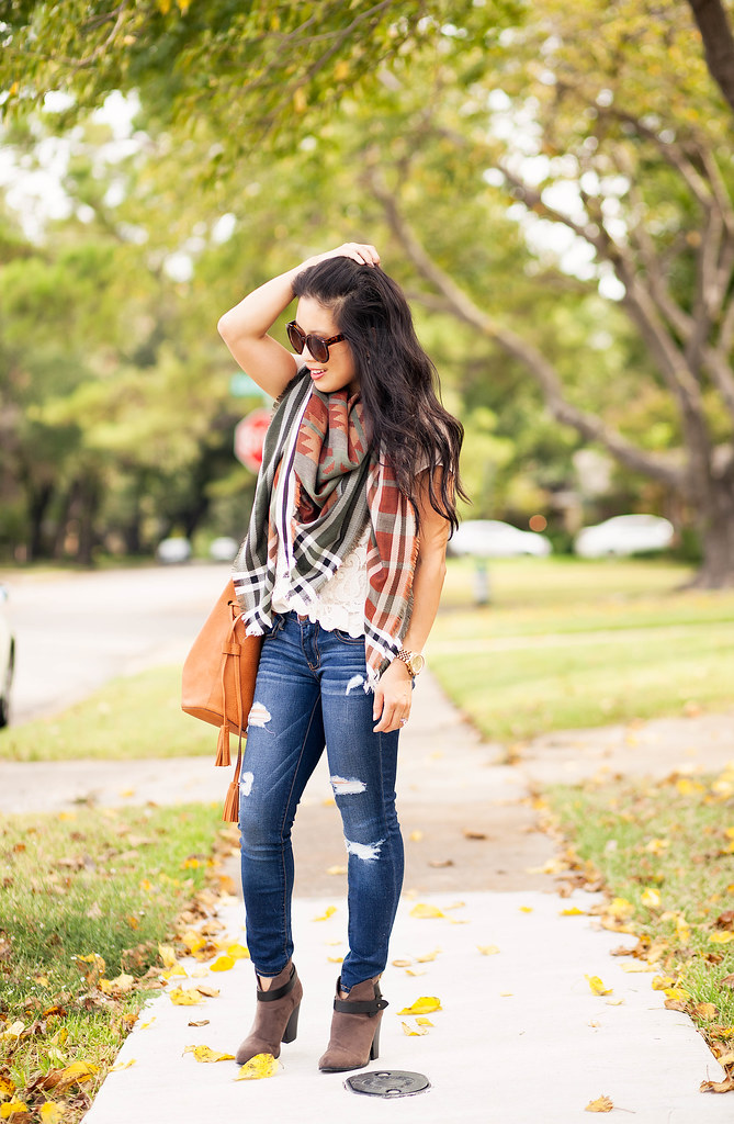 cute & little blog | petite fashion | fall blanket scarf, distressed jeans, tassel bucket bag, ankle boots | fall outfit