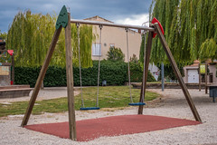 outdoor play equipment, swing, city, public space, playground,
