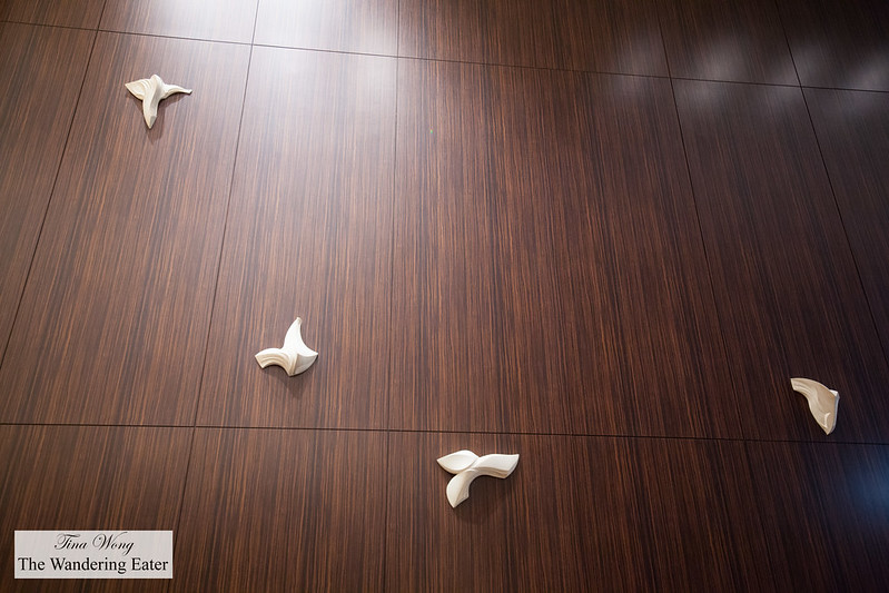 Abstract bird sculptures at hotel lobby wall