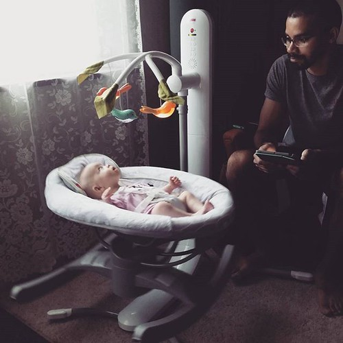 A very happy #lilburghers Daddy watching over his happy baby girl. Thank you @fisherprice for making our #twins happy! We love our 4-in-1 Smart Connect Cradle 'n Swing! #sponsored