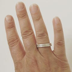 Pair of silver rings on my hand. I've gone for the filter that improves the wrinkles...