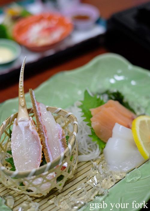 Crab sashimi on dry ice at Kani Honke in Sapporo, Hokkaido