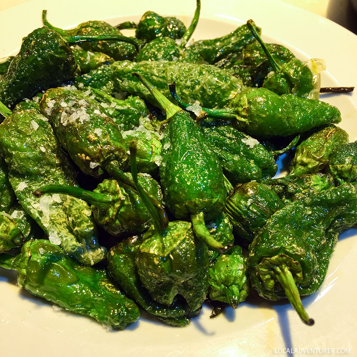 Pimientos de Padron is a green peppers dish served at most tapas joints. Also see the other 15 Spanish foods you must try.