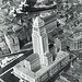 Fokker F.10 airplane flying over Los Angeles City Hall 1929 by Michael Locke
