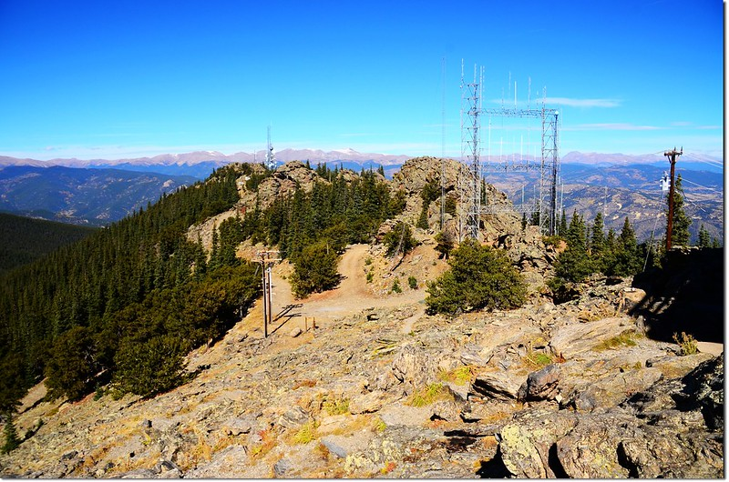 Squaw Mountain's communication tower studded summit with the peaks of James Peak Wilderness in the background