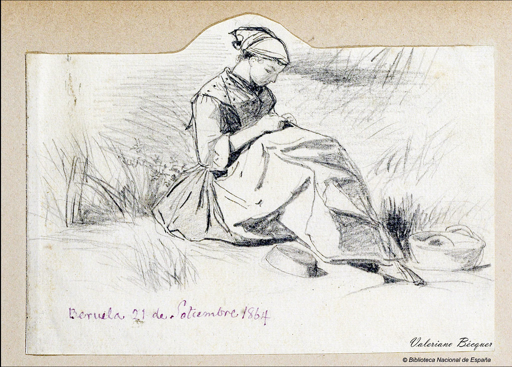 Mujer sentada sobre matorrales cosiendo