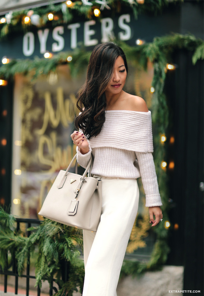 ivory off shoulder sweater pants prada saffiano cuir bag