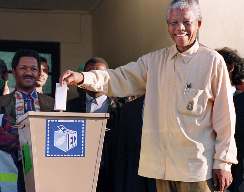 President Nelson Mandela casts his vote during South Africa's first all-race general elections
