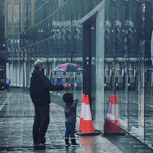 It is essential to be reminded that the love outnumbers the hate. Here's a selfless father in the rain.