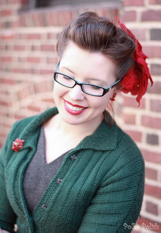 Retro holiday look with victory rolls, red lipstick and silk flowers