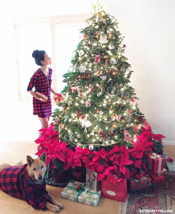 pointsettias plaid PJs under the christmas tree