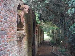 Busts on Wall along Path by Walled Garden, Lilies, Weedon