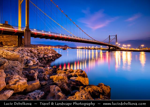 Oman - Sur - Cityscape with modern Khour Al Batah Suspension Bridge at Dusk - Blue Hour - Night - Twilight